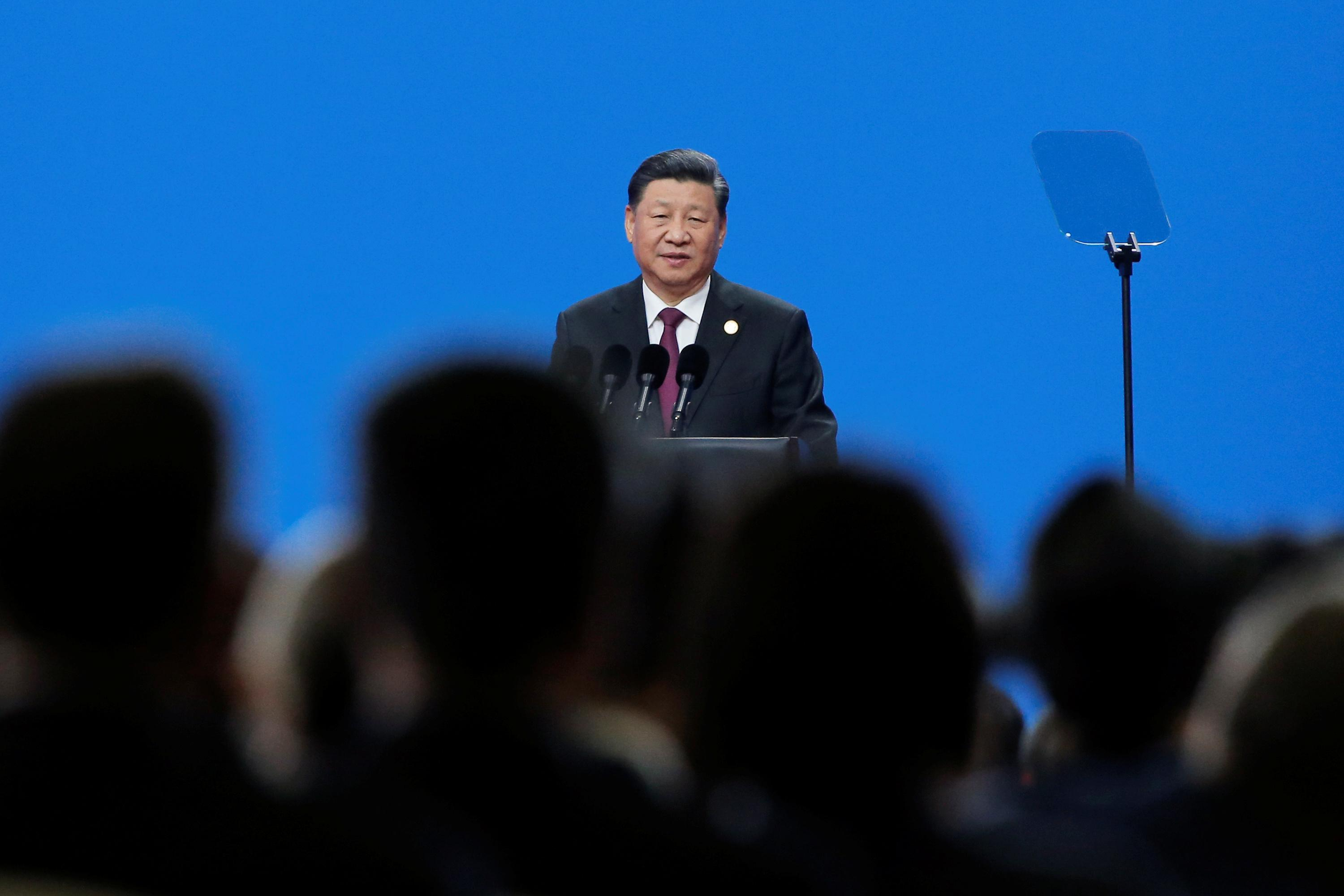China's Xi warns attempts to divide China will end in 'shattered...