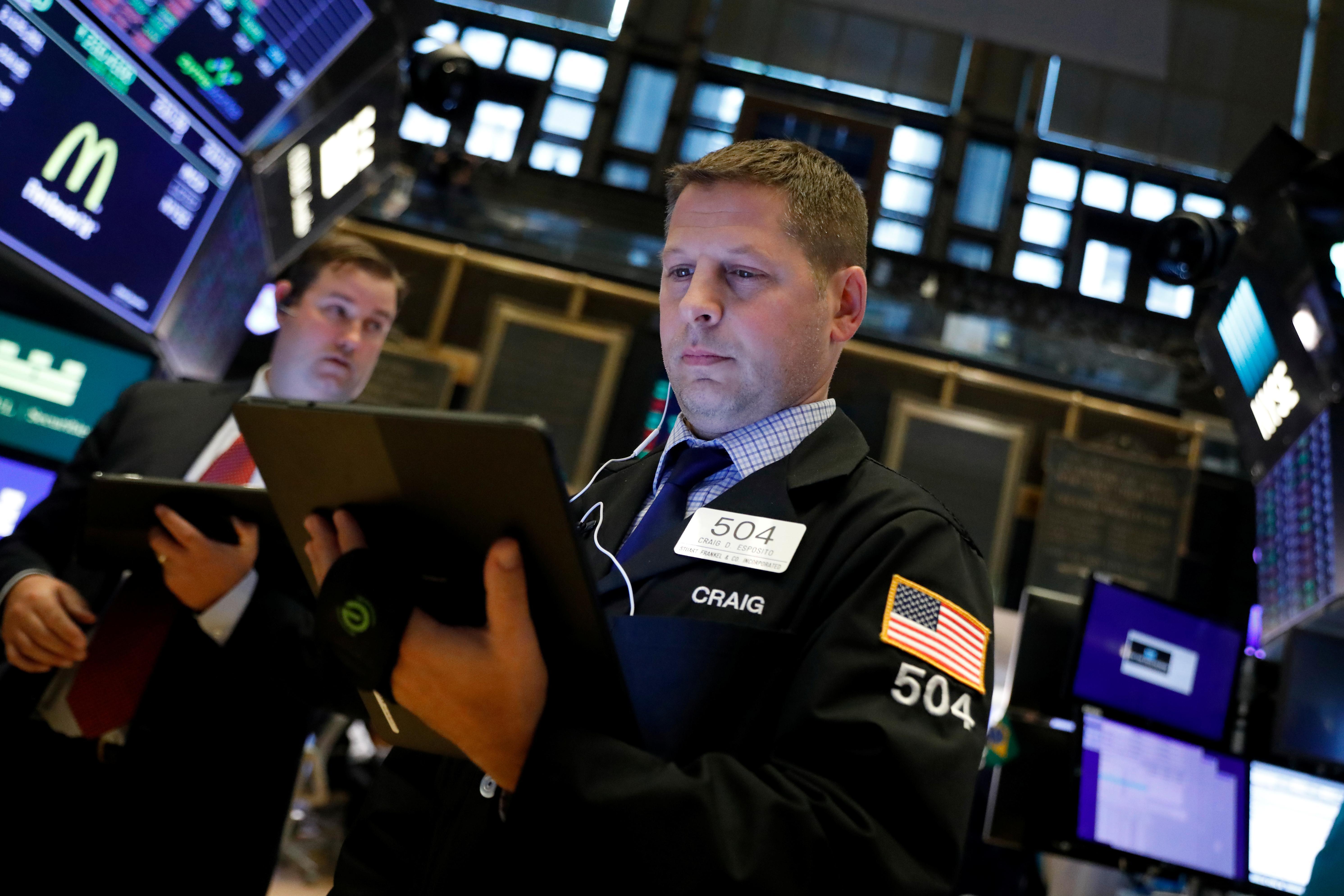 Wall Street slips as weak economic data offsets earnings strength