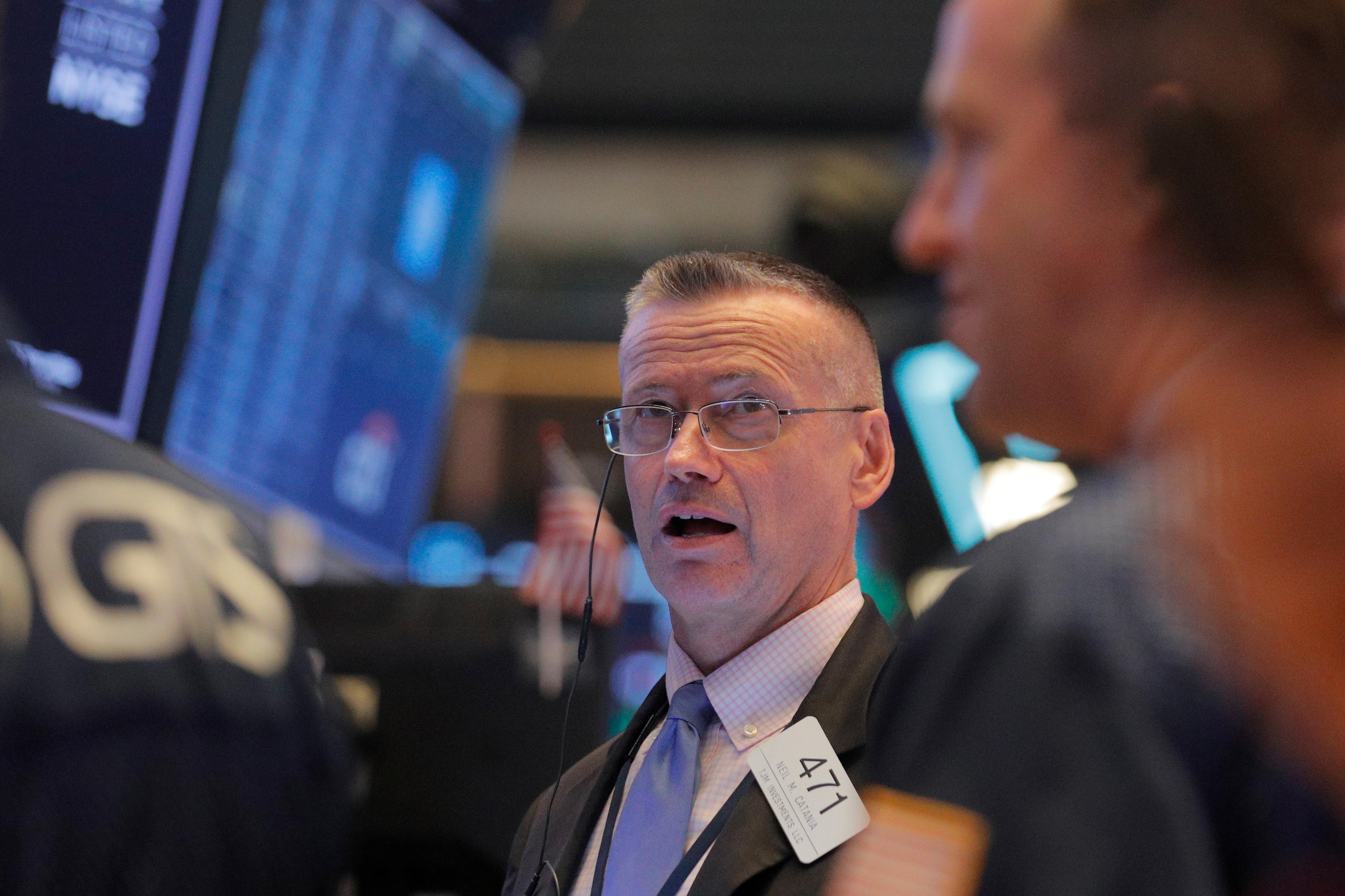 Stocks flat on data, earnings; pound volatile