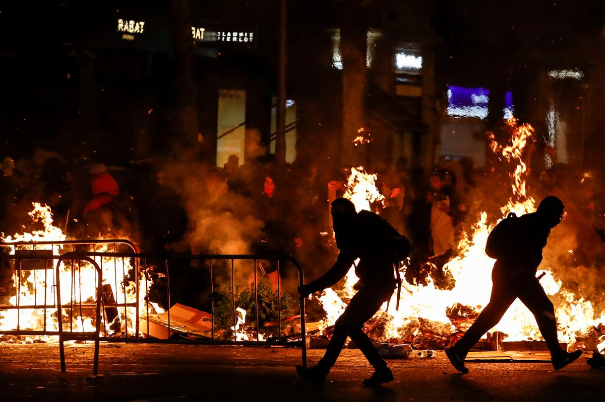 Street fires erupt in Barcelona in fourth day of Catalan protest