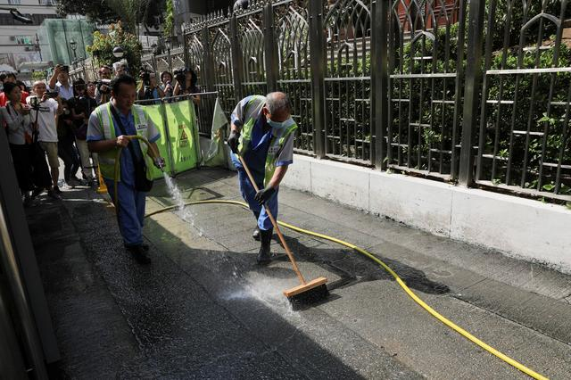 Cleaners wash the walkway outside Kowloon Masjid and Islamic Centre in Hong Kong's tourism district Tsim Sha Tsui, China, October 21, 2019. REUTERS/Ammar Awad