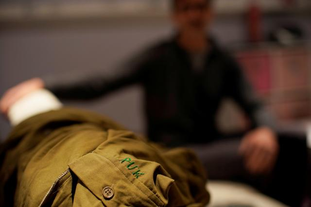 The Patriotic Union of Kurdistan (PUK) uniform of Mark Giaconia, who served for 20 years in the U.S. Army, of which 15 years in the U.S. Special Forces and was embedded with the Kurds in Iraq, is seen at his house in Herndon, Virginia, U.S., October 19, 2019. Picture taken October 19, 2019. REUTERS/Carlos Jasso