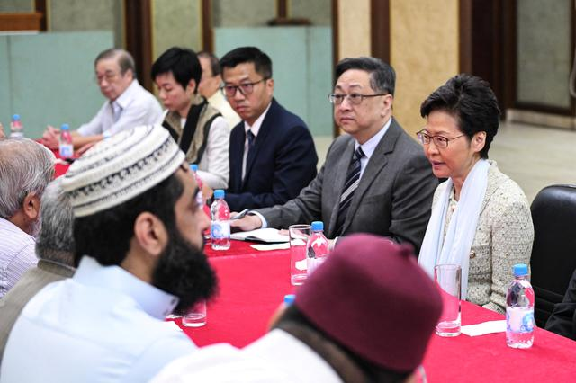 Hong Kong's Chief Executive Carrie Lam (R) and Commissioner of Police, Lo Wai-chung meet with representatives of the Incorporated Trustees of the Islamic Community Fund of Hong Kong and other leaders of the local Muslim community at the Kowloon Masjid and Islamic Centre in Tsim Sha Tsui, in Hong Kong, China October 21, 2019. Information Services Department/Handout via REUTERS  THIS IMAGE HAS BEEN SUPPLIED BY A THIRD PARTY. RESALES. NO ARCHIVES