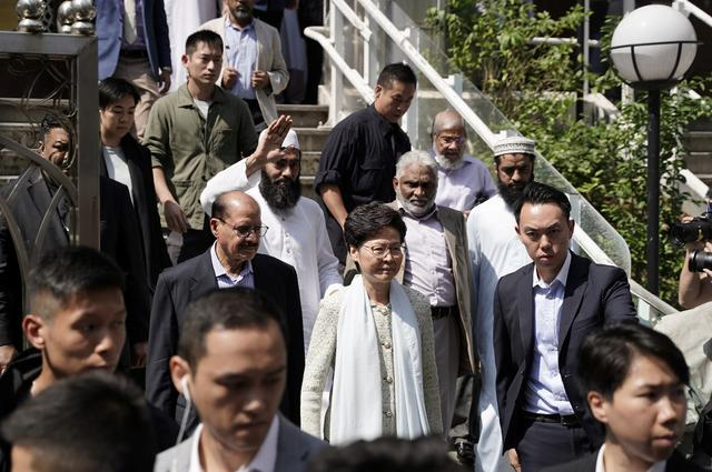 Hong Kong's Chief Executive Carrie Lam (C) exits the Kowloon Mosque, or Kowloon Masjid and Islamic Centre, in Tsim Sha Tsui district in Hong Kong, China October 21, 2019. REUTERS/Stringer  HONG KONG OUT. NO COMMERCIAL OR EDITORIAL SALES IN HONG KONG. TAIWAN OUT. NO COMMERCIAL OR EDITORIAL SALES IN TAIWAN. NO RESALES. NO ARCHIVES