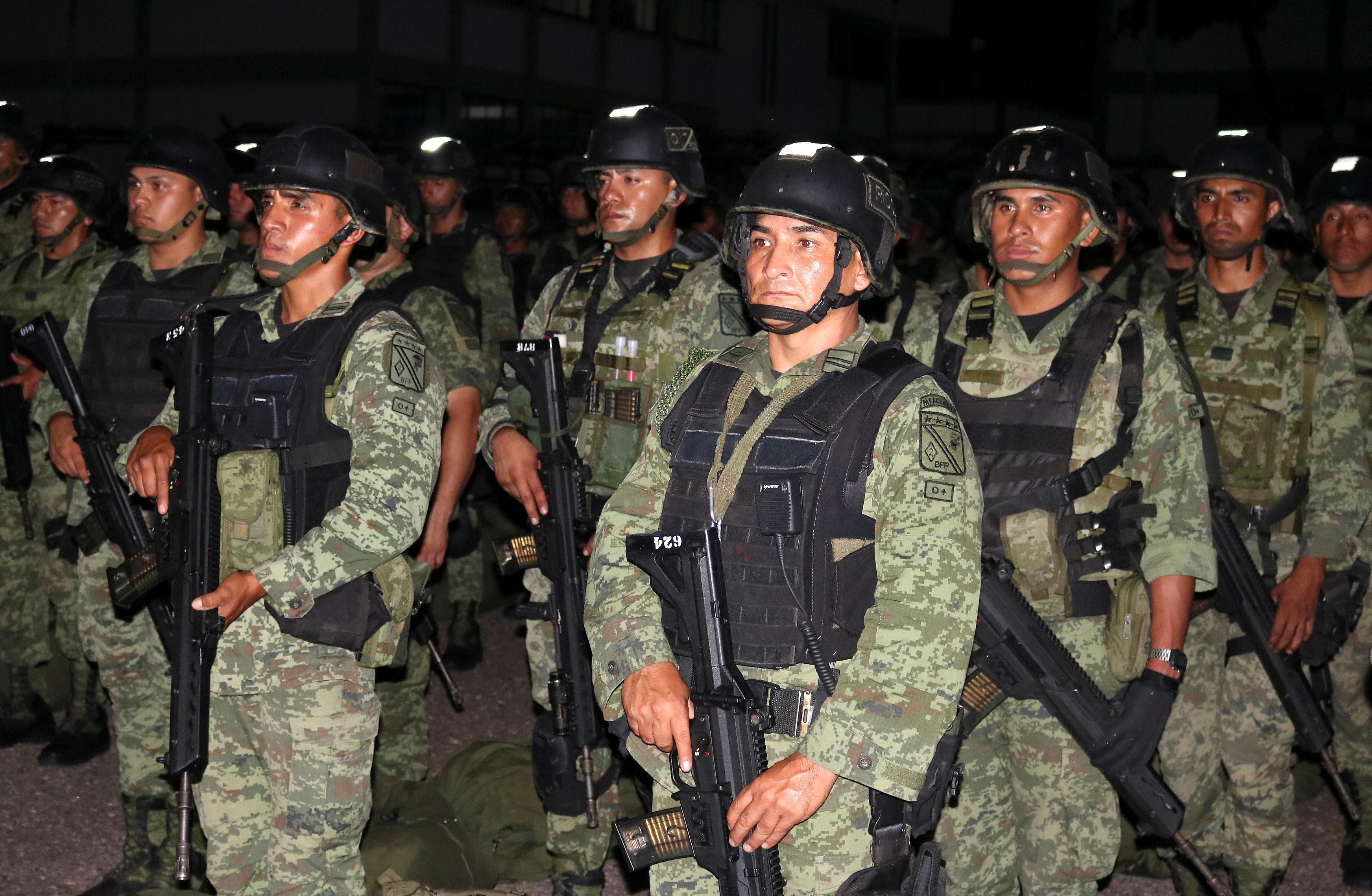 Mexico sends in elite troops to patrol city after cartel battle