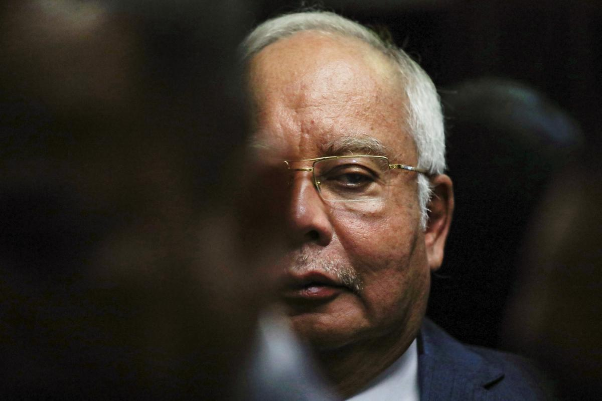Malaysia's Najib clueless about millions banked in his account, lawyers say