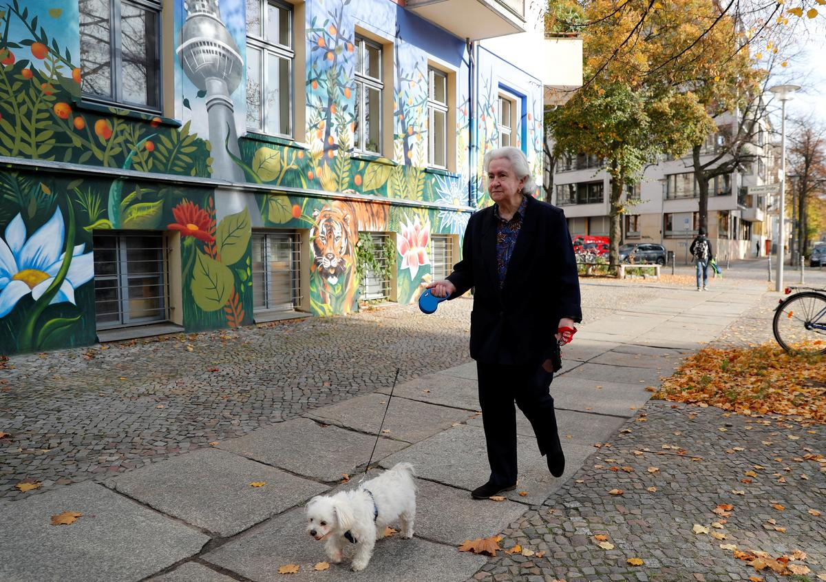 From Alice in Wonderland to walking the dog: Germans recall fall of Berlin Wall