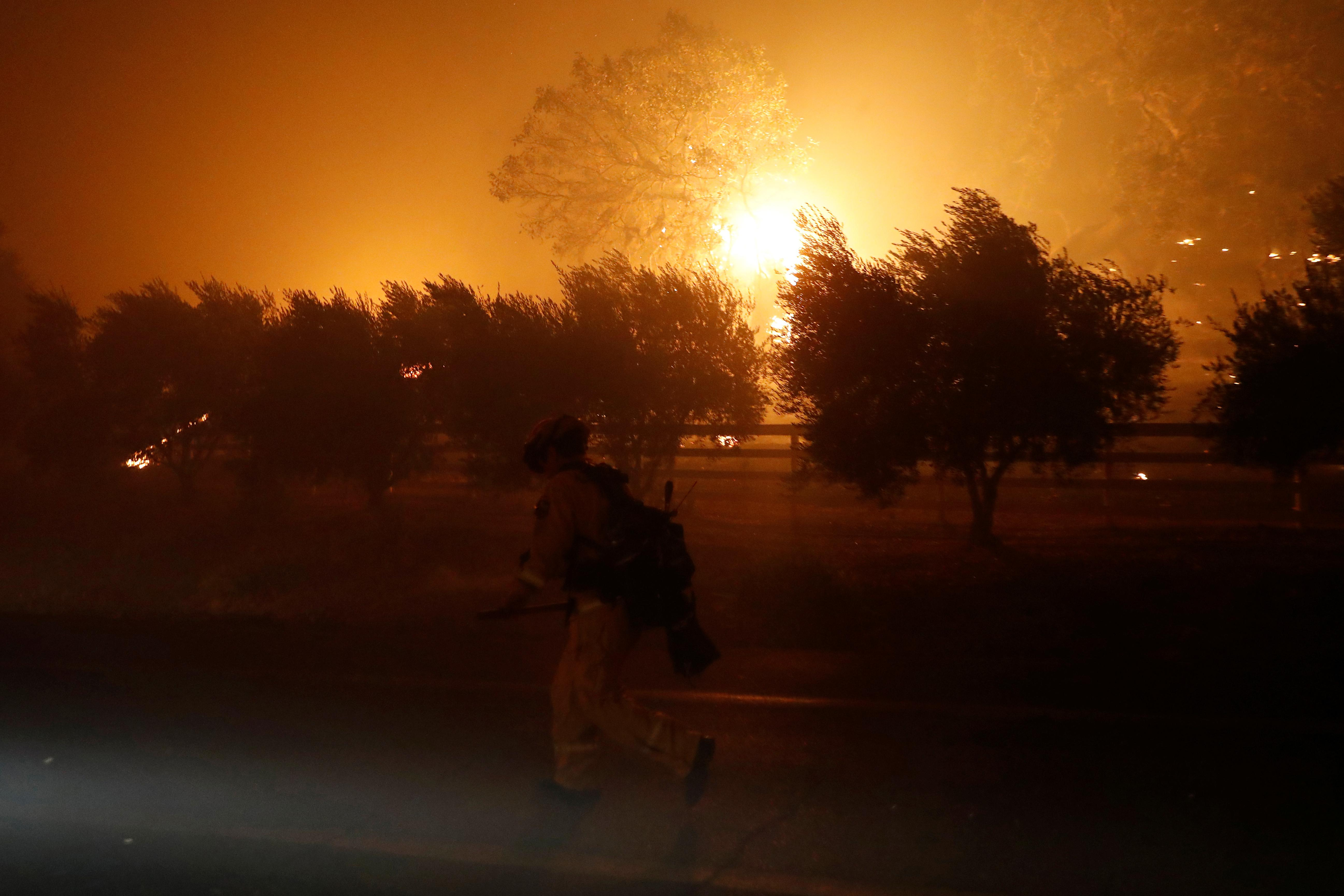California wildfires force evacuations, cause power outages
