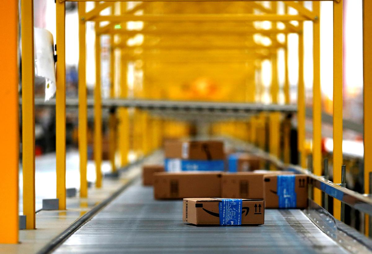Amazon's faster shipping dents profits, more pain to come