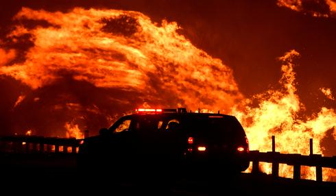 Fast-moving fires near Los Angeles force more than 40,000 to flee