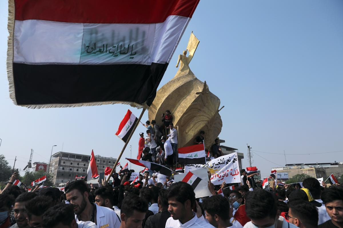 Iraqi security forces open fire on protesters, kill 14