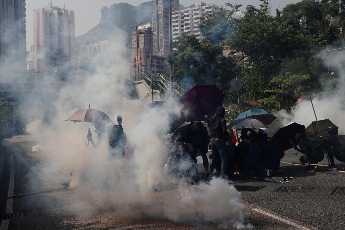Special Report: In a working-class Hong Kong neighborhood, the protests hit home