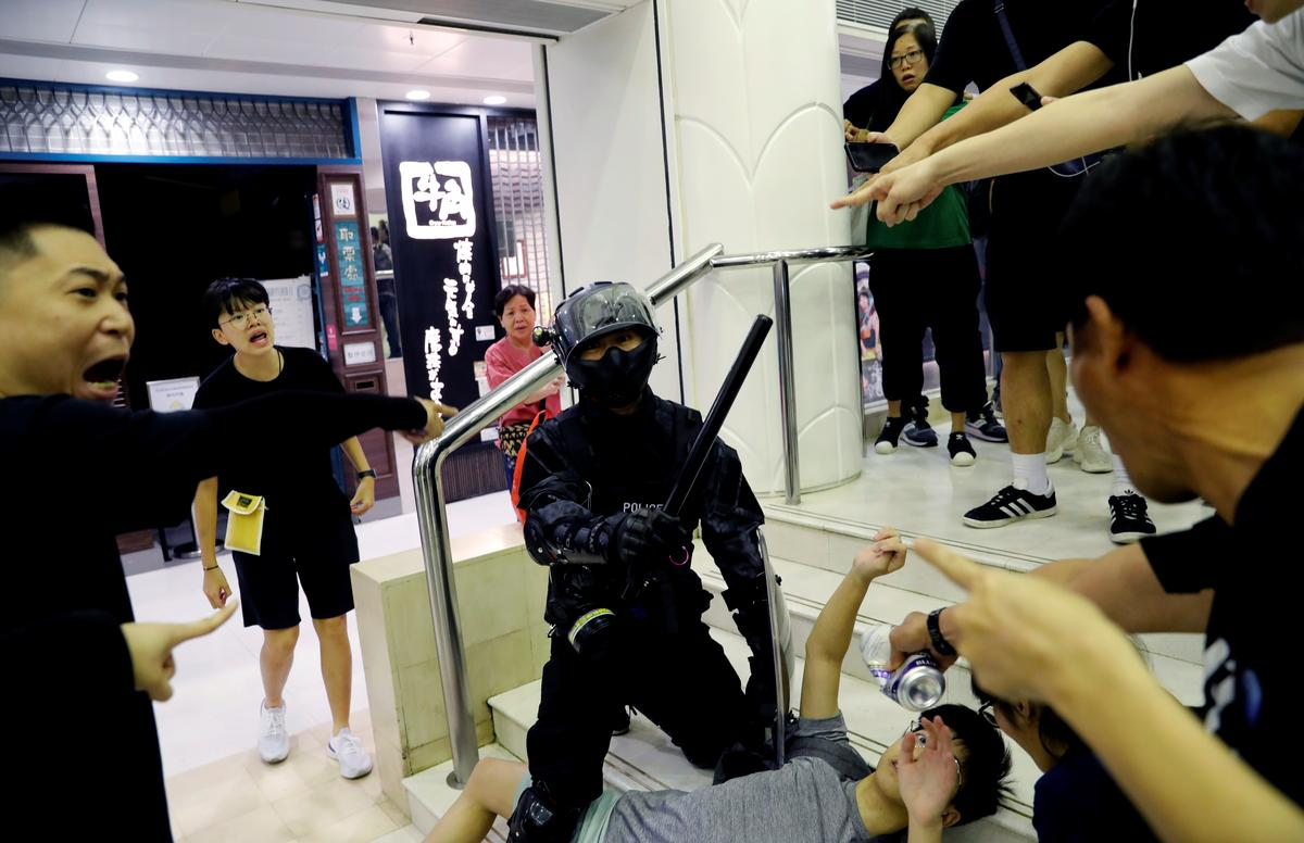 Three people in critical condition as protests rock 'heavy-hearted' Hong Kong