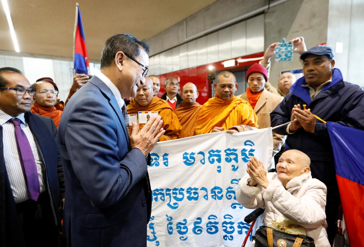 Cambodia opposition founder says he was blocked from boarding plane...