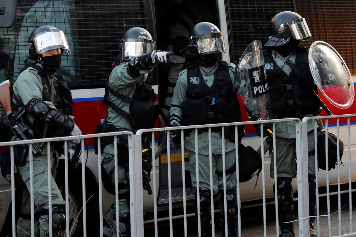 Hong Kong protesters shot by police as chaos erupts across city: Cable TV