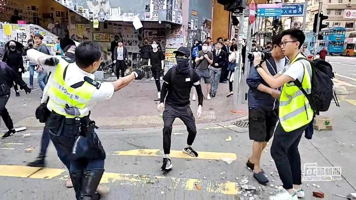 Hong Kong police officer shoots protester as violence flares
