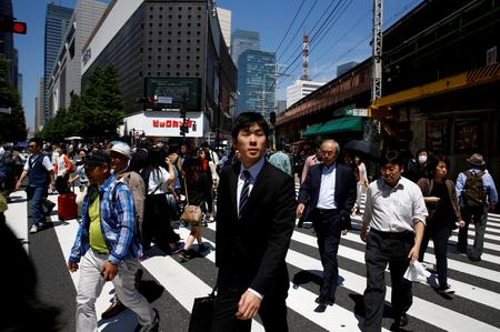 UPDATE 2-Japan's economy nearly stalls in Q3, growth at 1-year low as trade war bites