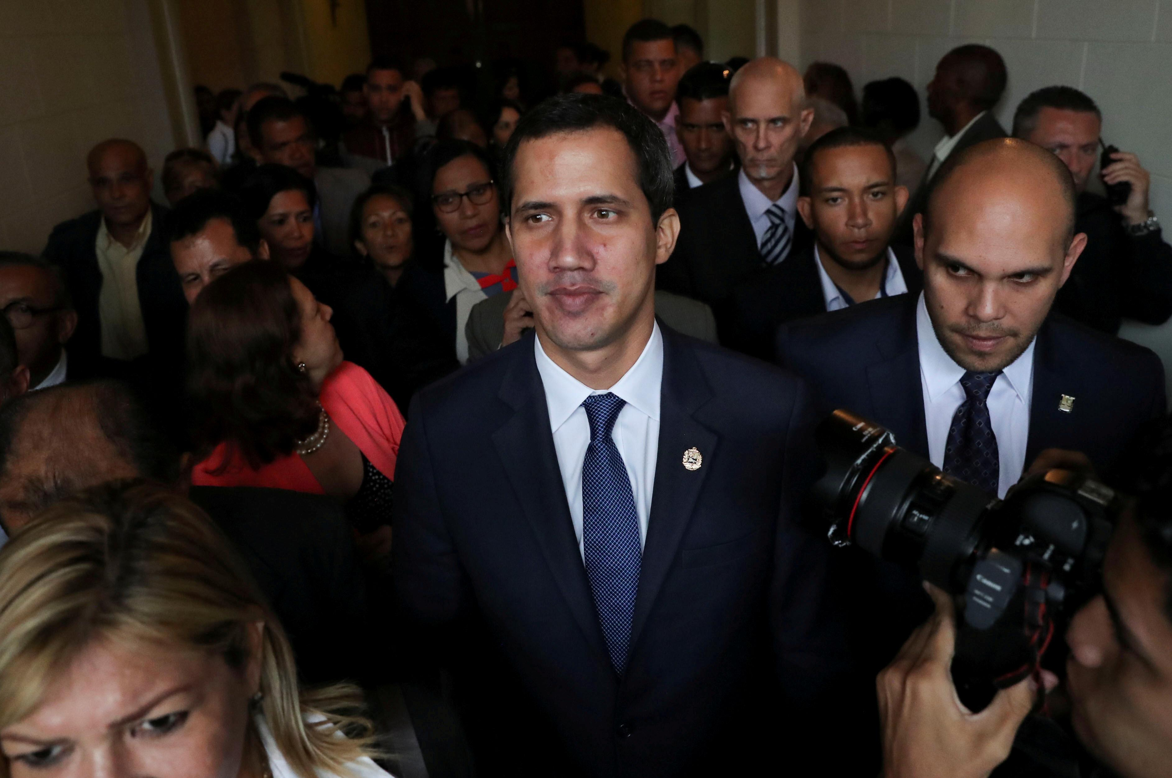 Masked men break into Venezuela opposition party offices on eve of...