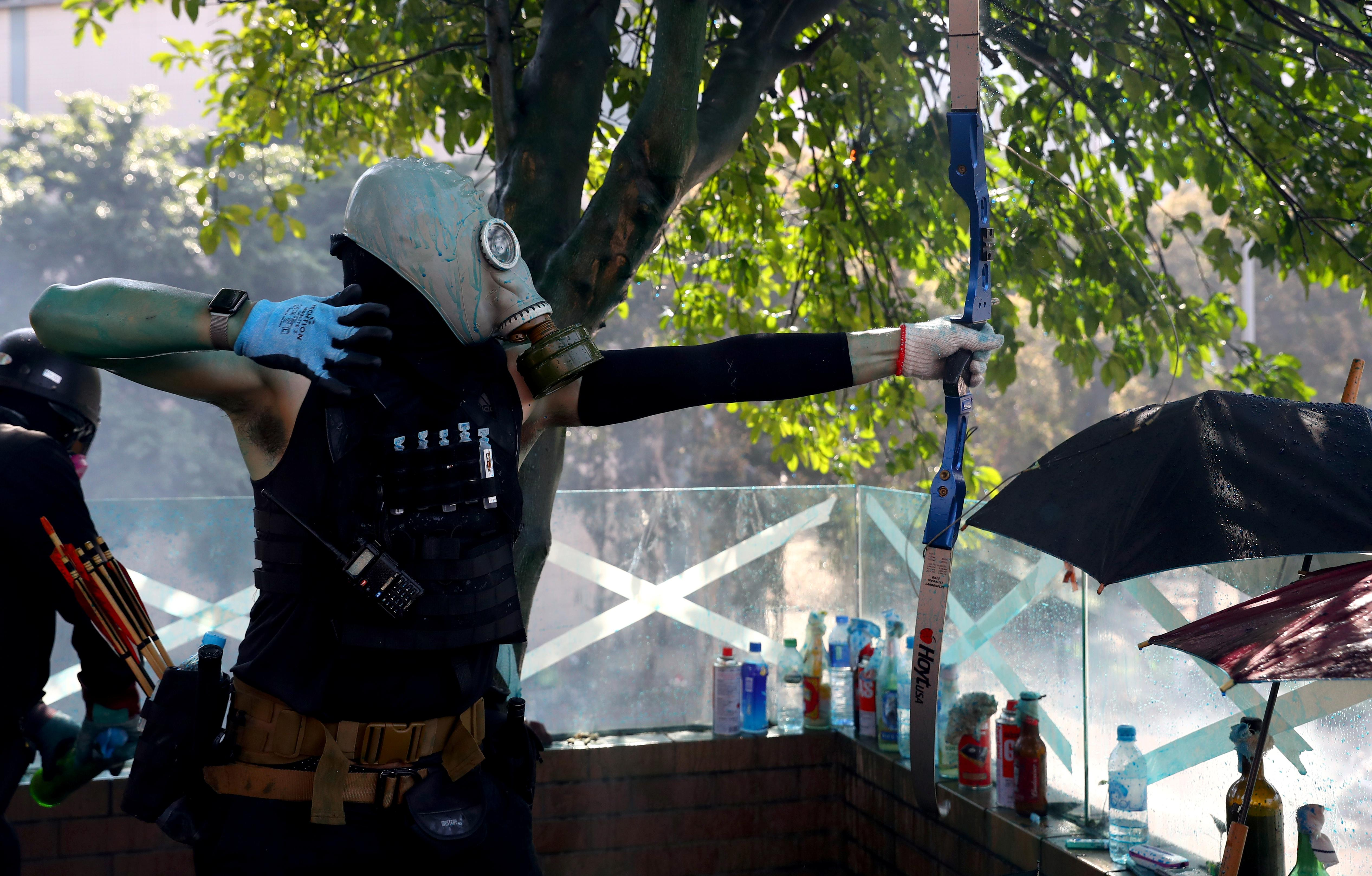Hong Kong campus protesters fire arrows as unrest spreads across...