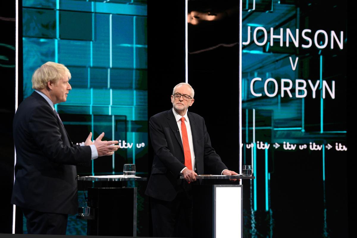 In testy leadership debate, UK PM Johnson promises quick Brexit