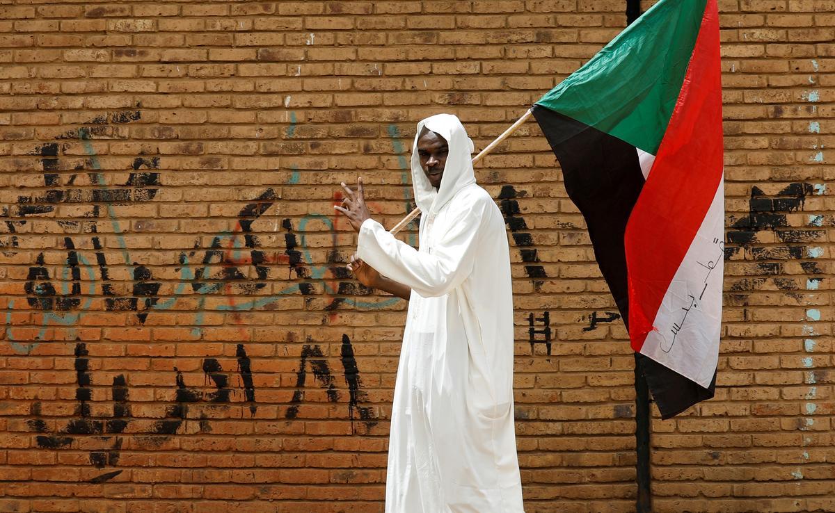 Sudan's top Islamist politician sent to prison holding Bashir