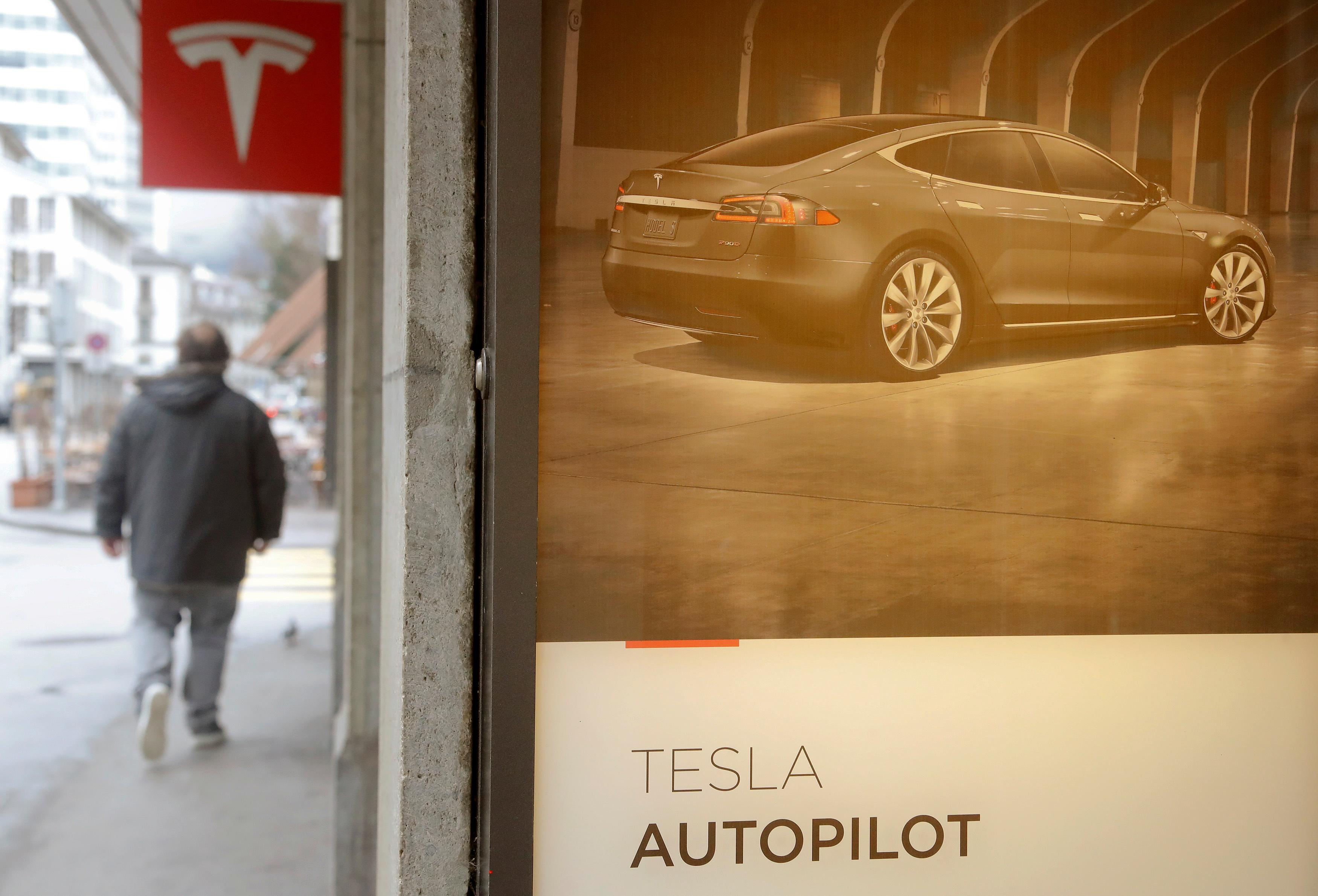 Tesla needs safeguards to prevent drivers from sleeping on...