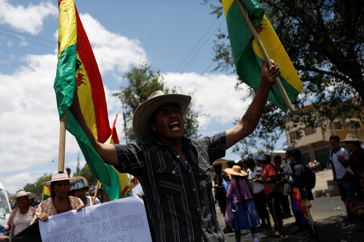 Bolivia government proposes election bill as death toll mounts