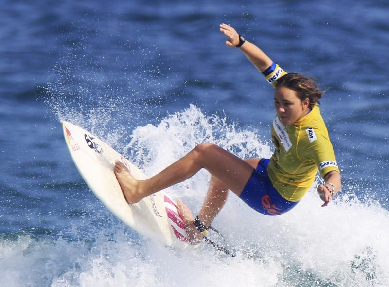 Surfing - Hawaii's Moore wins fourth world title, books Olympics berth