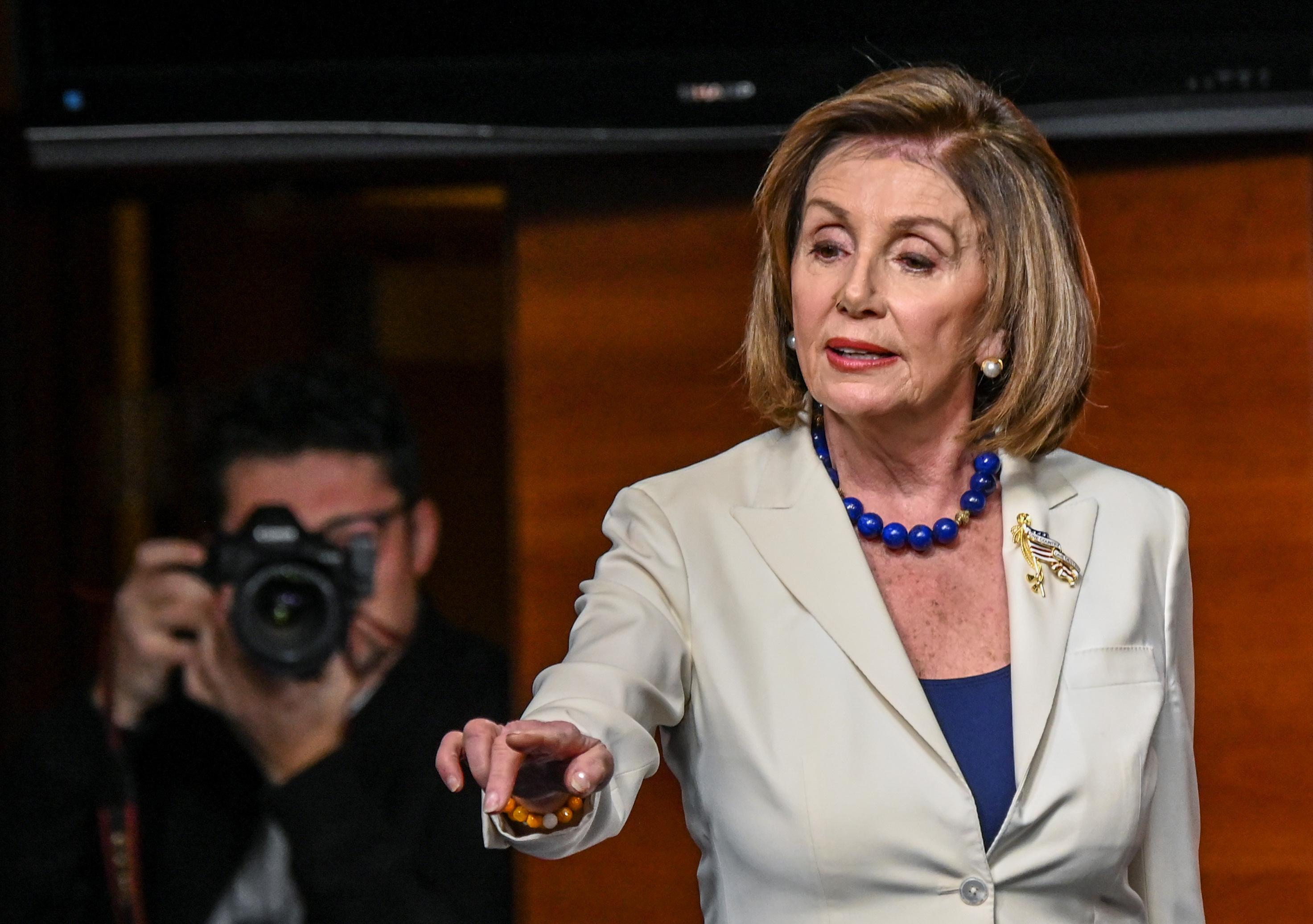 House Speaker Pelosi calls Trump a 'coward,' tells reporter: 'Don't...