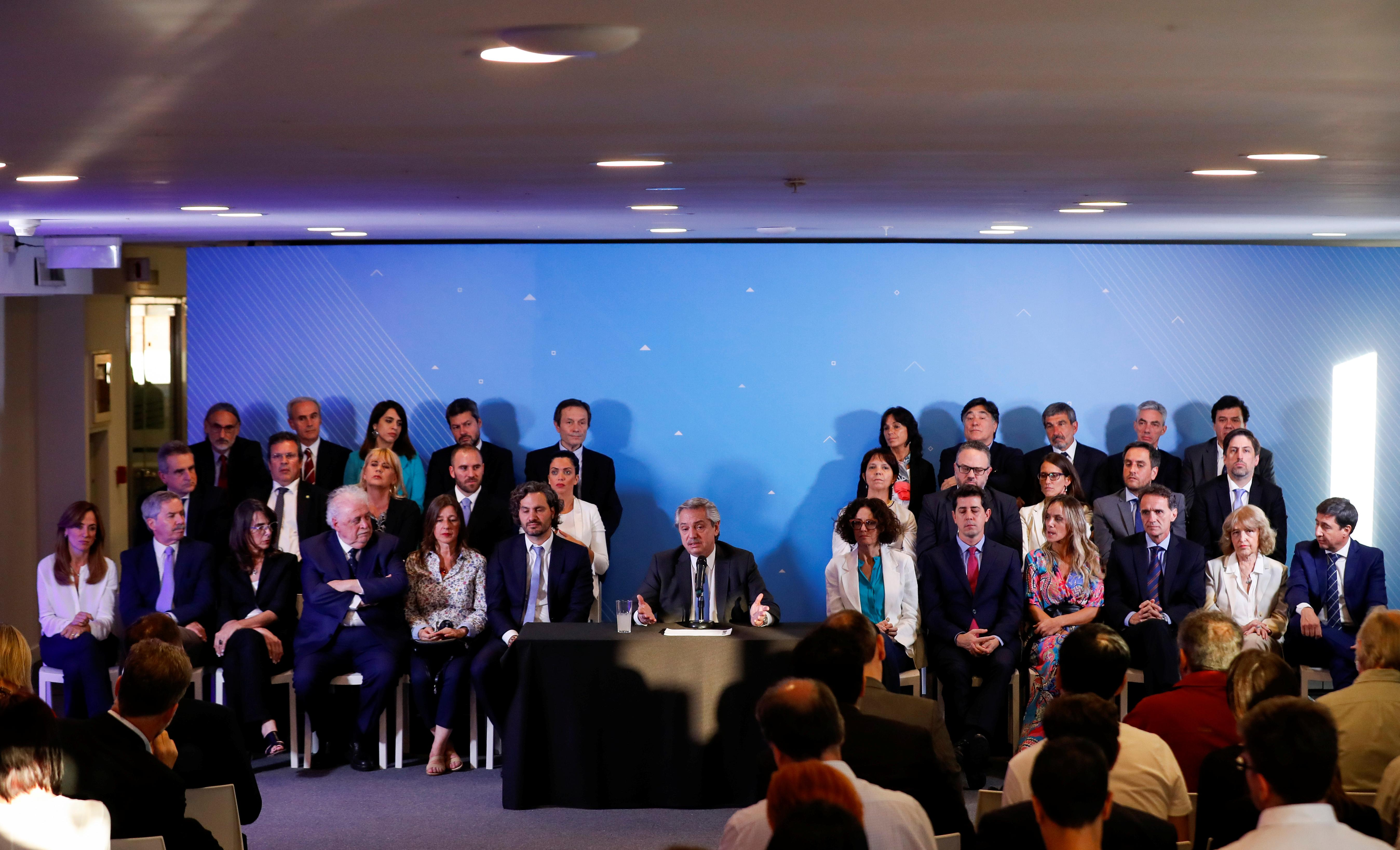 Argentina's Fernandez signals policy shifts with new cabinet,...
