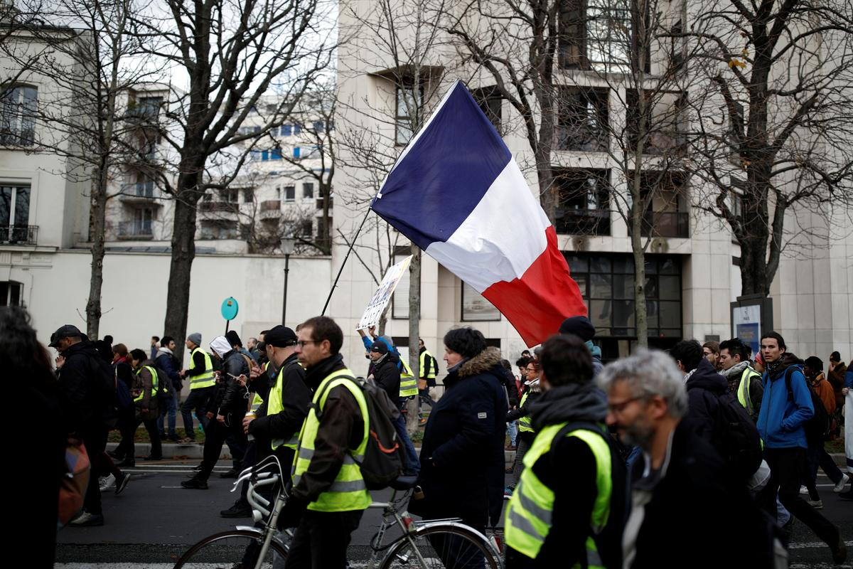 More French protests see roads blocked, trains disrupted and...