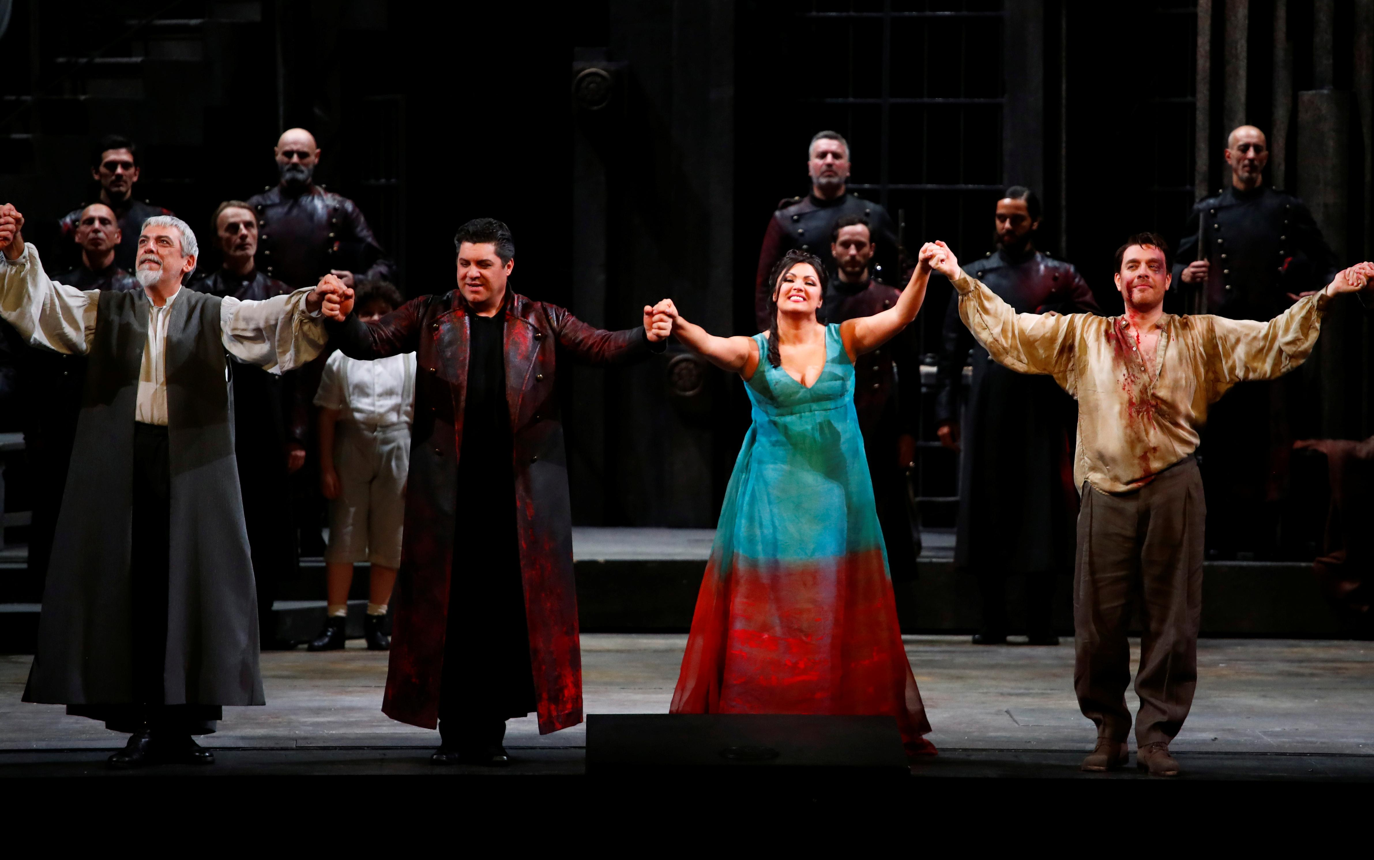 'Tosca' with a touch of cinema enthrals Milan's La Scala at opening...