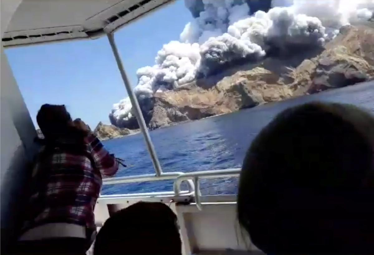 New Zealand volcano webcam captures tourists in crater moments...