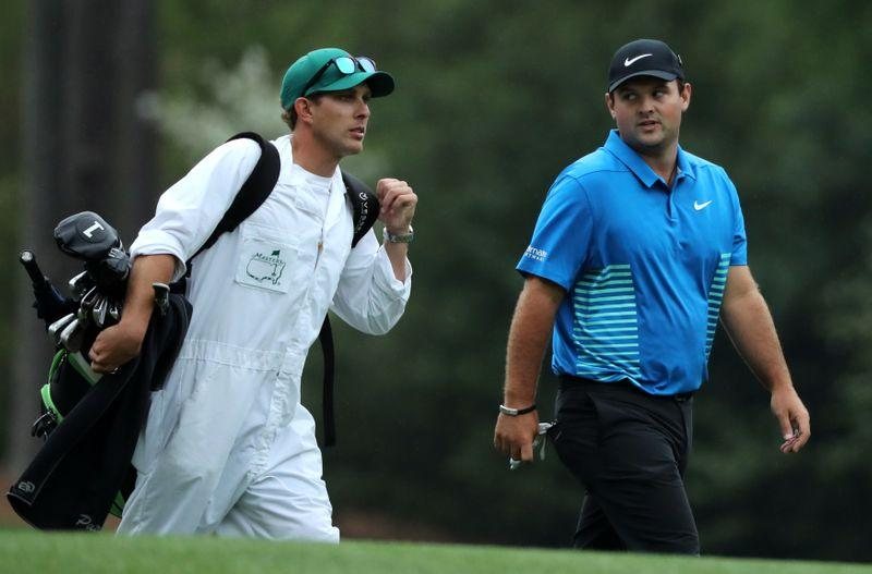 Woods calls on fans be 'respectful' after Reed's caddie clash
