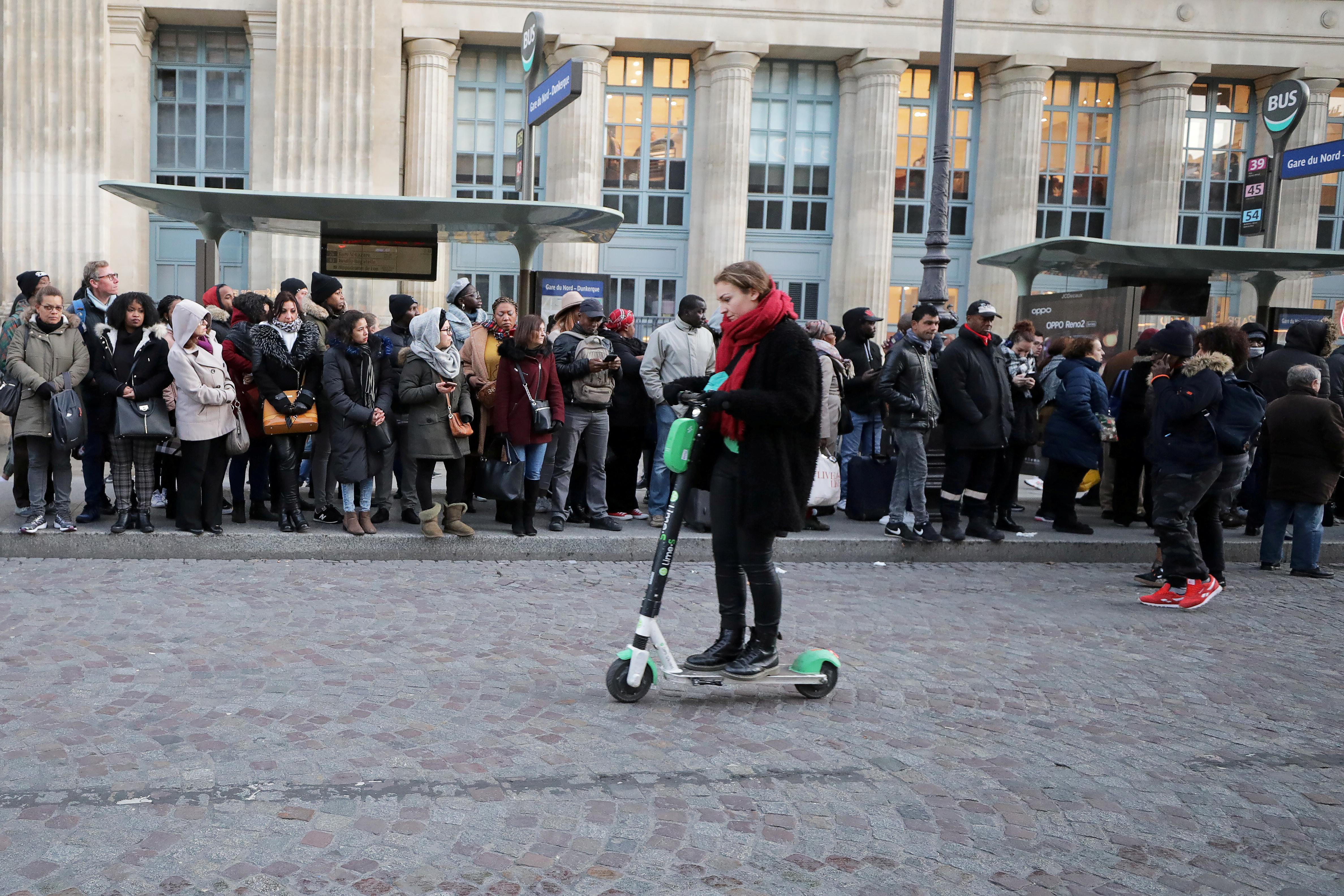 Paris commuters jump on scooters as transport strikes block metro