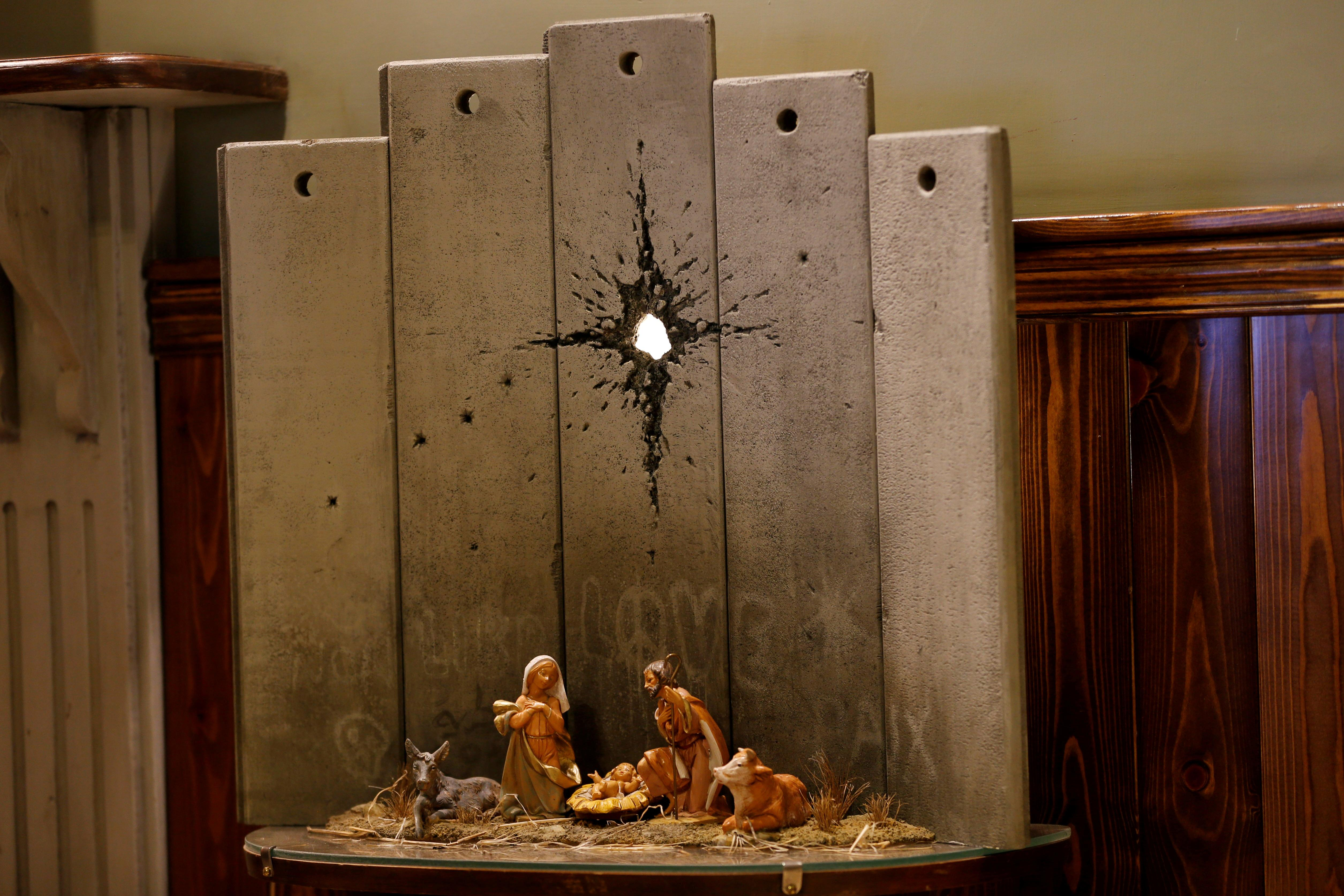 Banksy's 'Scar of Bethlehem' nativity unveiled in West Bank hotel