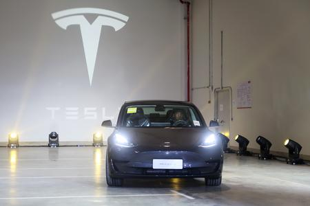 Tesla cuts price for China-made Model 3 vehicles before delivery