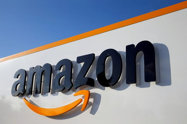 FILE PHOTO: The logo of Amazon is seen at the company logistics centre in Boves, France, August 8, 2018. REUTERS/Pascal Rossignol/File Photo