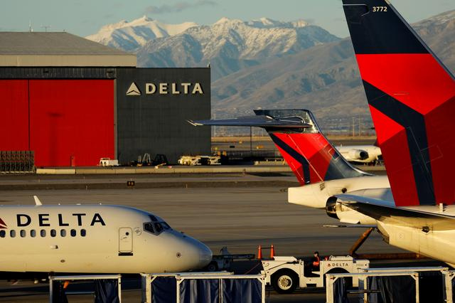 FILE PHOTO: A Delta Air Lines flight is pushed put of its gate at the airport in Salt Lake City, Utah, U.S., January 12, 2018. REUTERS/Mike Blake