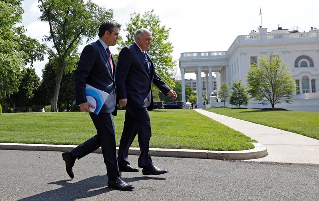 FILE PHOTO: Ford CEO James Hackett with Global Automakers CEO John Bozzella arrive for a White House meeting between senior executives from U.S. and foreign automakers and U.S. President Donald Trump in Washington, U.S., May 11, 2018. REUTERS/Kevin Lamarque