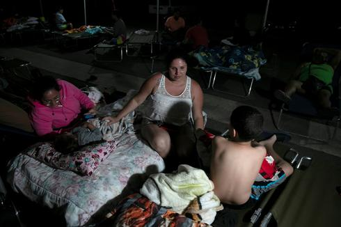 Puerto Ricans sleep outside after 'devastating' earthquake