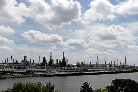 REFILE-UPDATE 1-U.S. refinery sales hit the brakes, with 5% of capacity on block