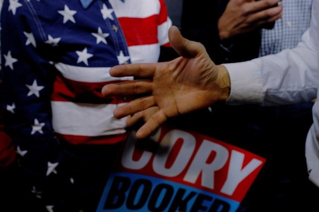 FILE PHOTO: Democratic 2020 U.S. presidential candidate and U.S. Senator Cory Booker (D-NJ) gestures while talking to audience members during a campaign stop in Portsmouth, New Hampshire, U.S., February 16, 2019.   REUTERS/Brian Snyder/File Photo