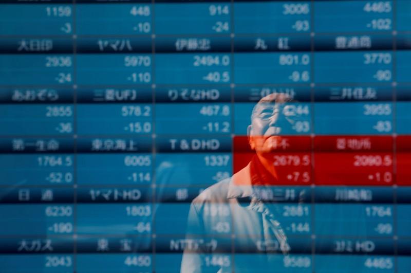 Record high stocks pause to gauge Sino-U.S. trade outlook, company earnings