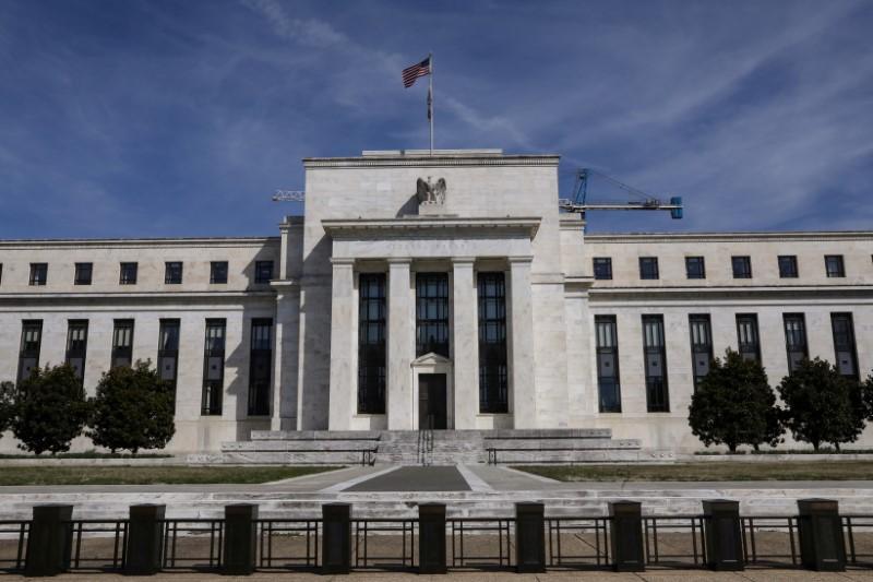 Fed sees U.S. economy on track, Trump renews Fed gripes