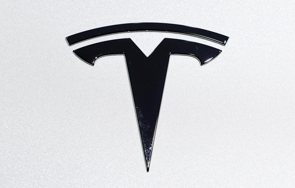 New Tesla registrations in California nearly halve in fourth...