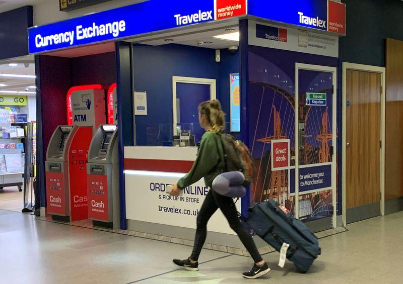 Travelex staff put away pens and paper as UK systems come back online