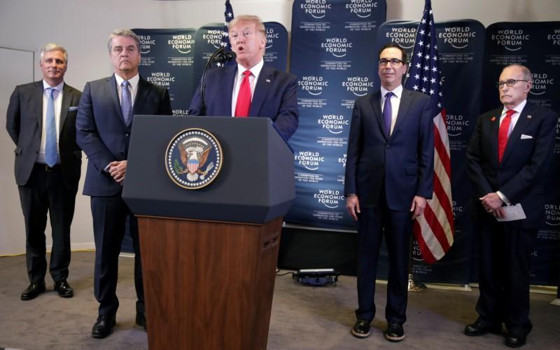 Trump touts U.S. economy, dismisses climate 'prophets of doom' as...
