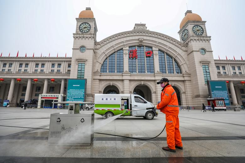 A worker sanitizes the square in front of the Hankou Railway Station, closed after the city of Wuhan was locked down following the outbreak of a new coronavirus, in Wuhan, Hubei province, China January 23, 2020. China Daily via REUTERS