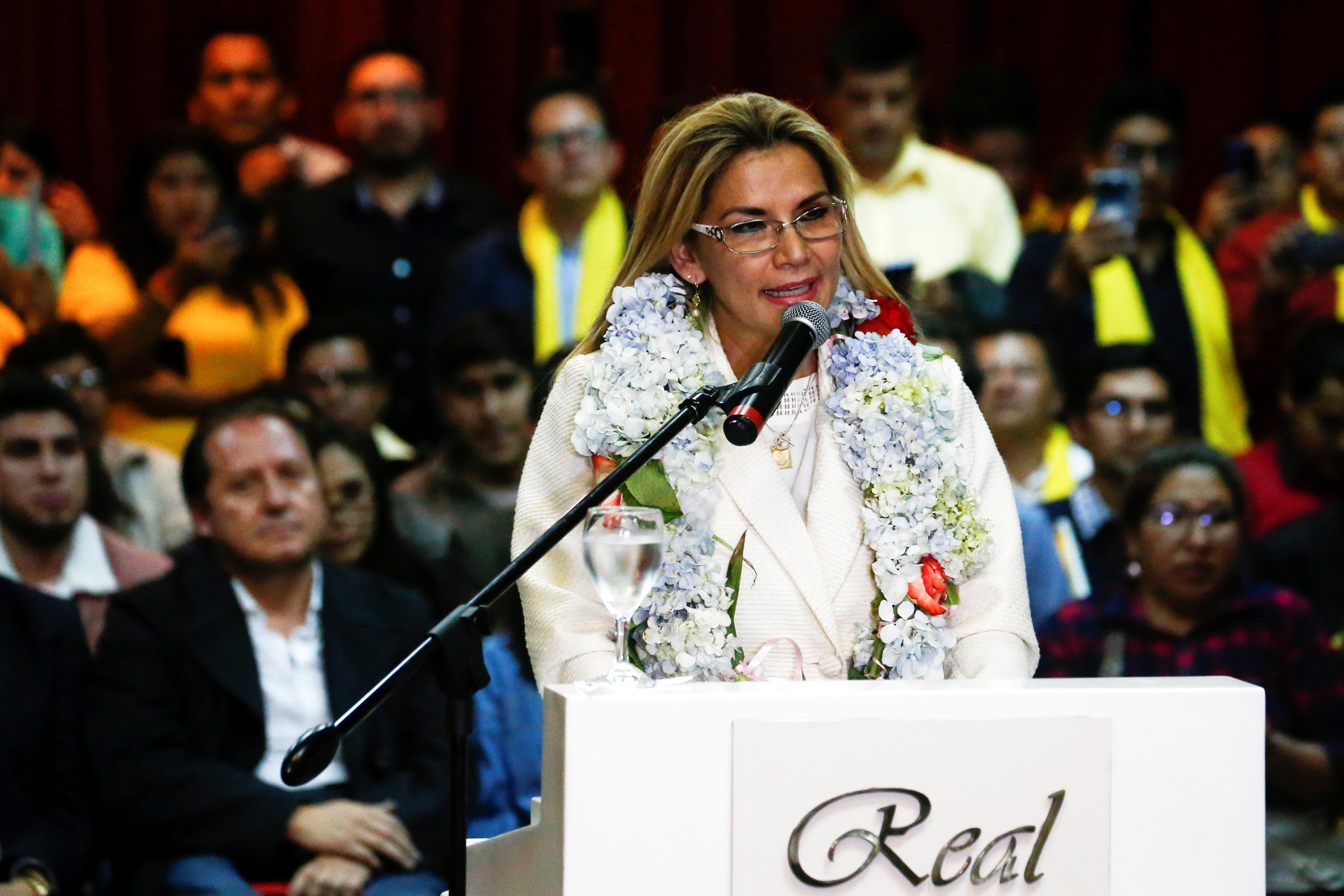 Bolivia's interim President Anez shakes up election race with plan...